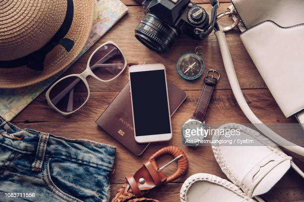 high angle view of objects on table - brown shoe stock pictures, royalty-free photos & images
