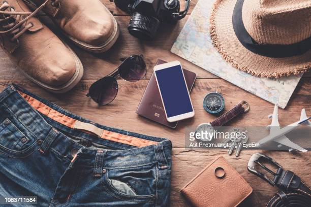 high angle view of objects on table - menswear stock pictures, royalty-free photos & images