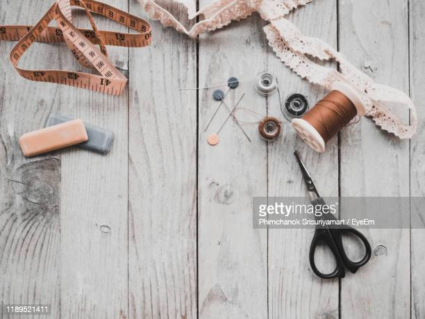 high angle view of objects on table - sewing stock pictures, royalty-free photos & images
