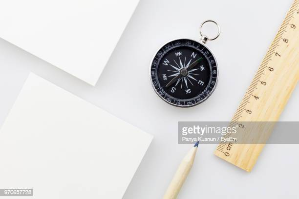 high angle view of objects on table - compass stock pictures, royalty-free photos & images