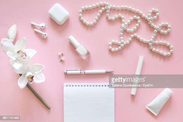 high angle view of objects on table - pearl jewelry stock pictures, royalty-free photos & images