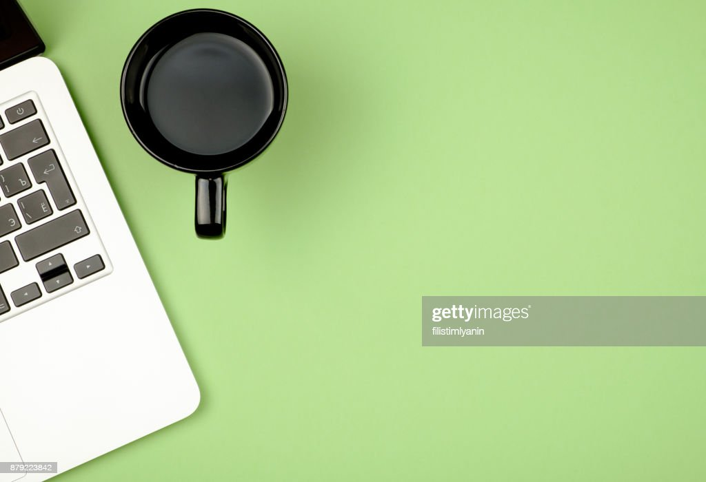 https://media.gettyimages.com/photos/high-angle-view-of-office-colored-desk-with-copy-space-table-with-picture-id879223842