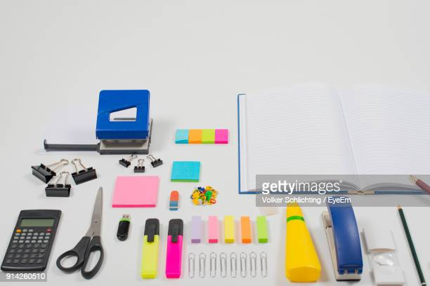 High Angle View Of Office Supplies Arranged On White Background