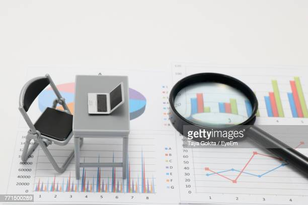 High Angle View Of Office Supplies Over White Background