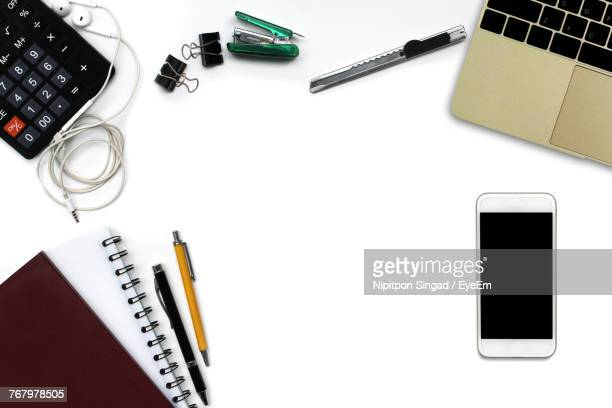 High Angle View Of Office Supplies With Laptop On White Background