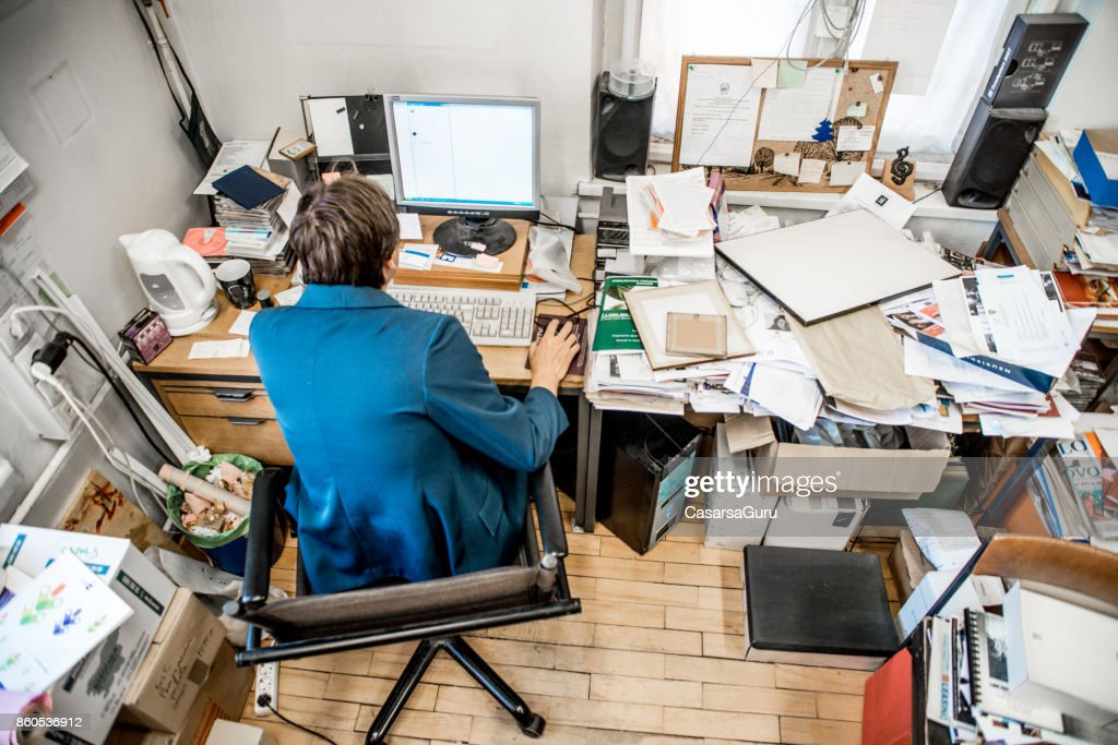 High Angle View Of Office Worker Working On Computer : Stock Photo
