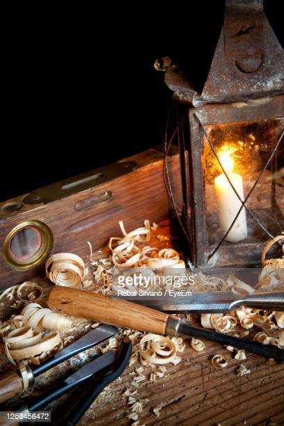 high angle view of oil lamp with work tools on table - rebai silvano foto e immagini stock