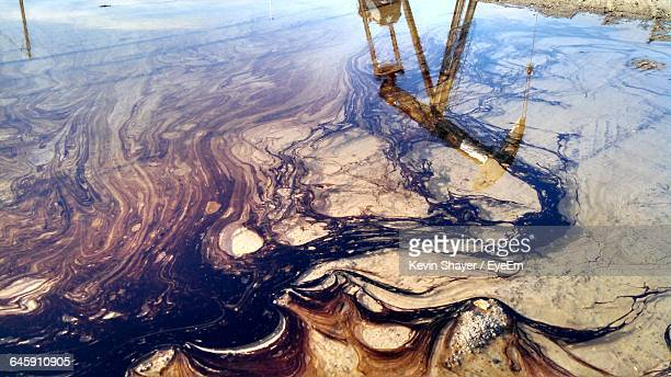 high angle view of oil spill on water - oil spill stock pictures, royalty-free photos & images