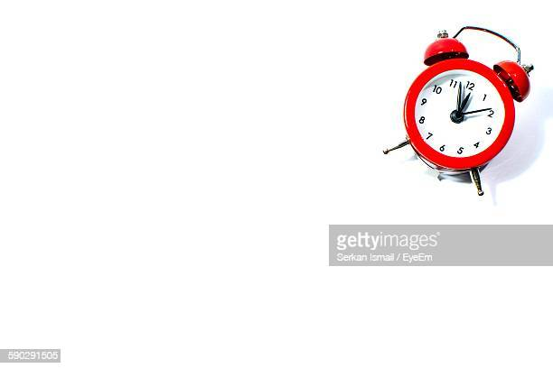 High Angle View Of Old Alarm Clock On White Background