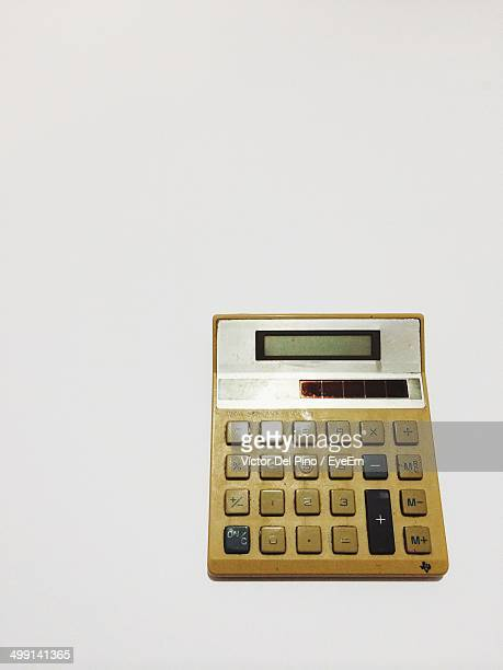 High angle view of old calculator against white background