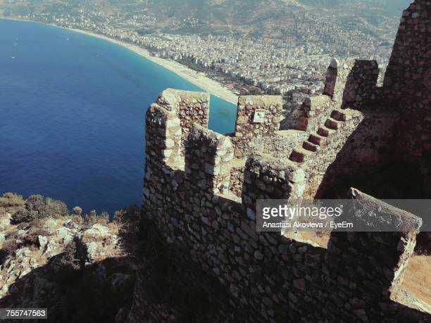 high angle view of old fort by sea - anastasi foto e immagini stock