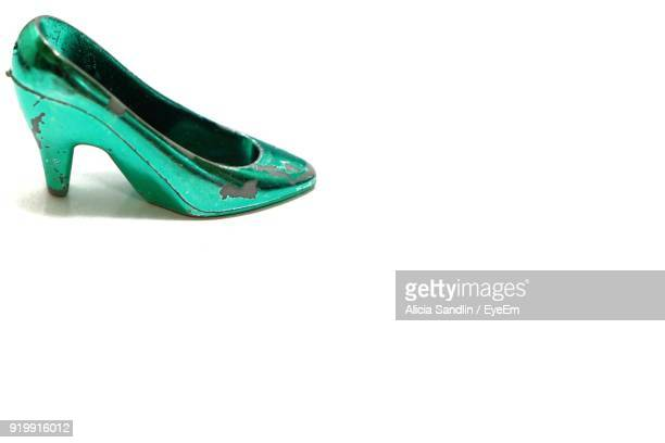 High Angle View Of Old Green High Heels On White Background
