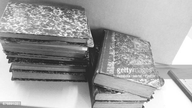 high angle view of old hardcover books stack on table - rebecca haertel stock-fotos und bilder