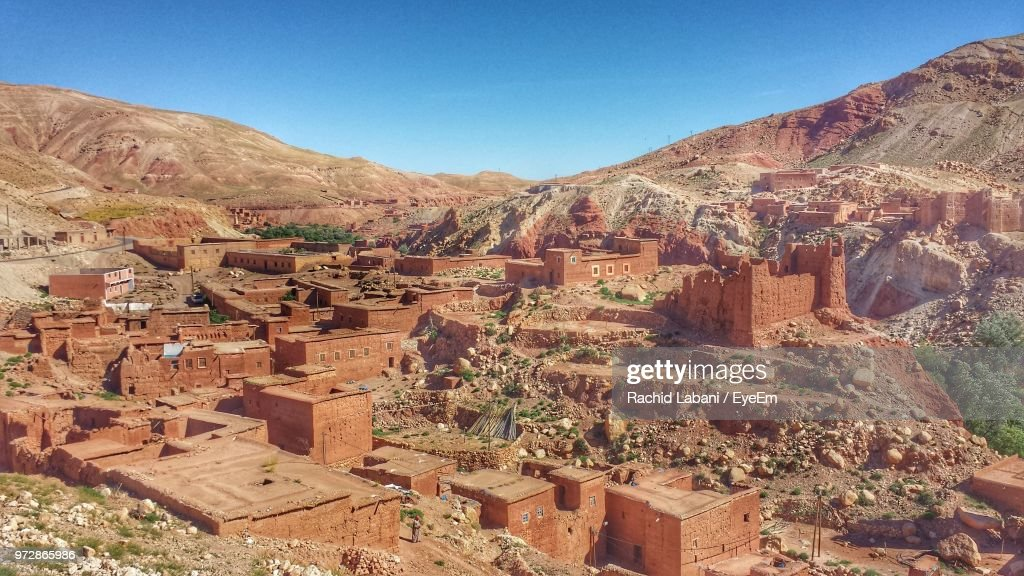High Angle View Of Old Houses And Mountains Against Clear Sky : Stock Photo