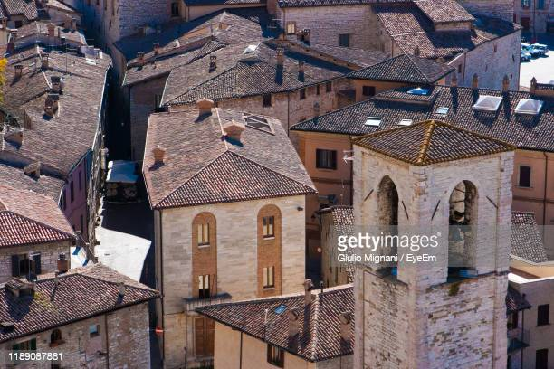 high angle view of old houses in city - gubbio stock pictures, royalty-free photos & images