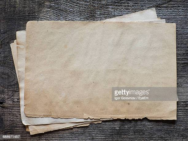 High Angle View Of Old Papers On Wooden Table
