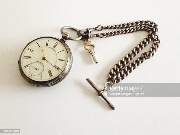 High Angle View Of Old Pocket Watch On Table