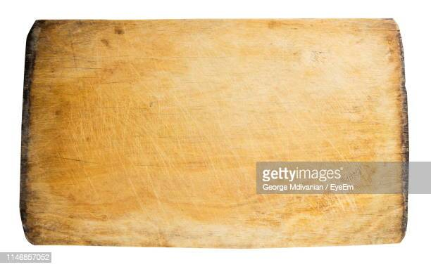 high angle view of old wooden cutting board on white background - george wood stock pictures, royalty-free photos & images