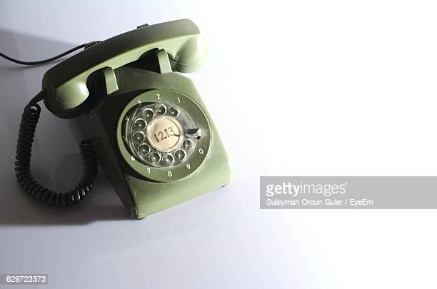 High Angle View Of Old-Fashioned Telephone On White Background
