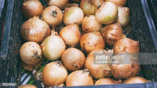 high angle view of onions in basket for sale at market - cebolla fotografías e imágenes de stock