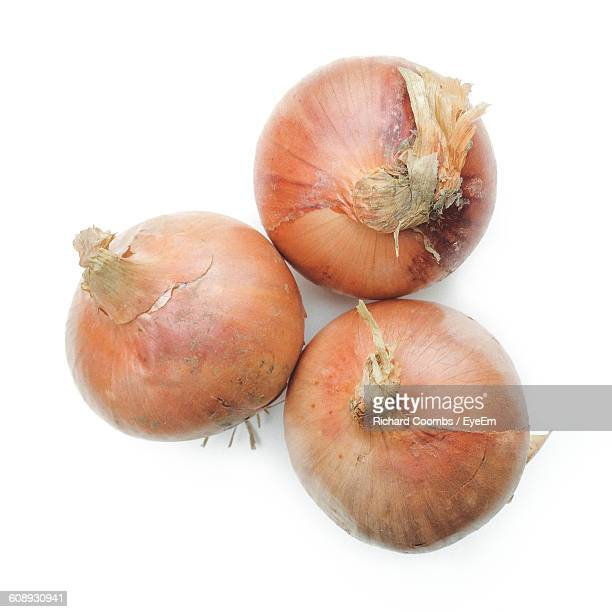 High Angle View Of Onions On White Background