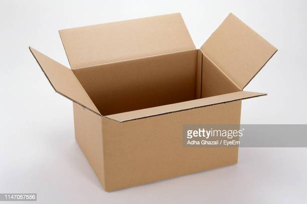 high angle view of open box on white background - cardboard box stock pictures, royalty-free photos & images