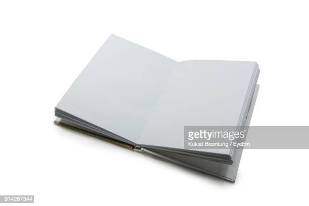 high angle view of open gray book over white background - open book stock photos and pictures