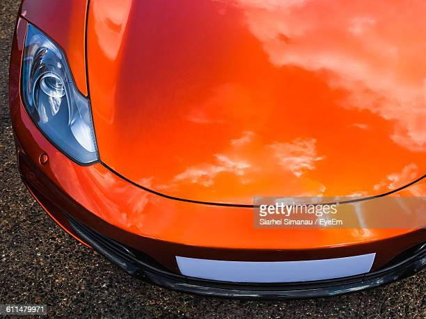 High Angle View Of Orange Car On Road