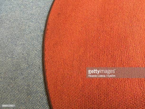 High Angle View Of Orange Carpet On Floor