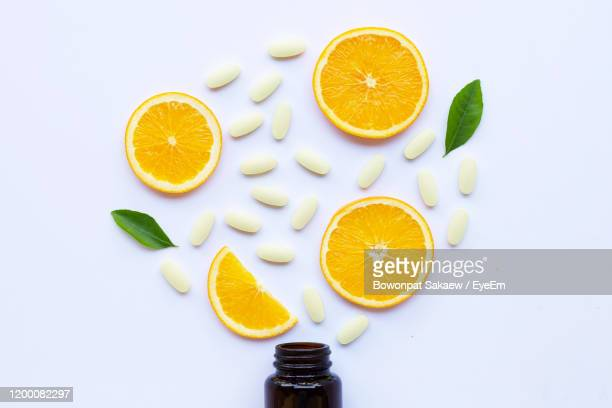 high angle view of orange fruit on white background - vitamin c stock pictures, royalty-free photos & images