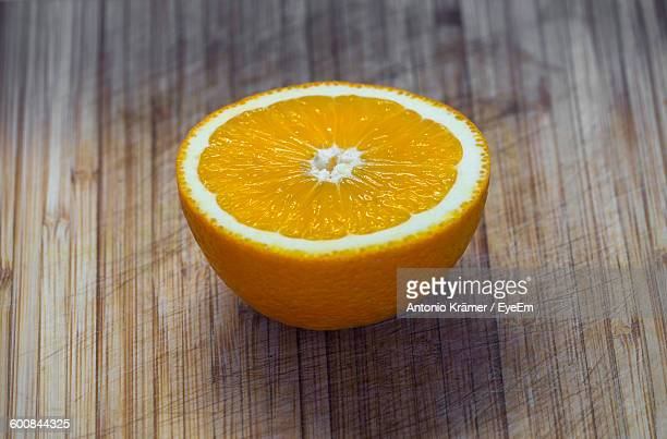 High Angle View Of Orange Slice On Table