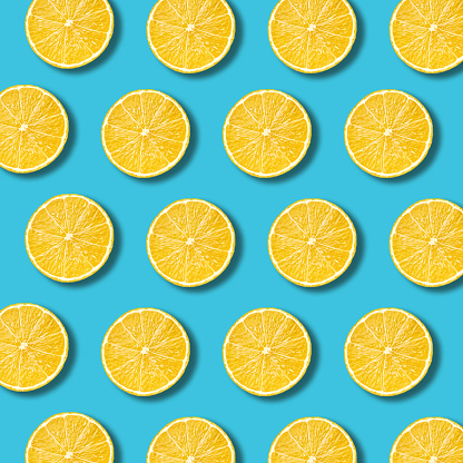 High Angle View Of Orange Slices On Blue Background - gettyimageskorea