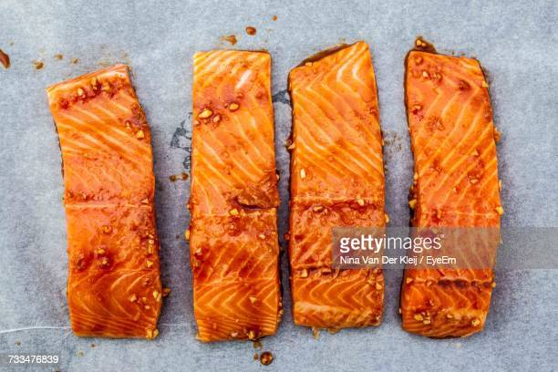 High Angle View Of Orange Smoked Salmon Over Blue Background