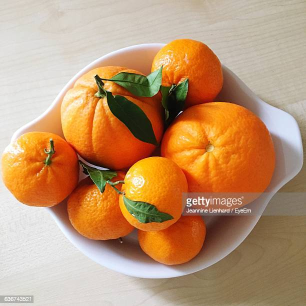 high angle view of oranges in container on table - lienhard stock pictures, royalty-free photos & images