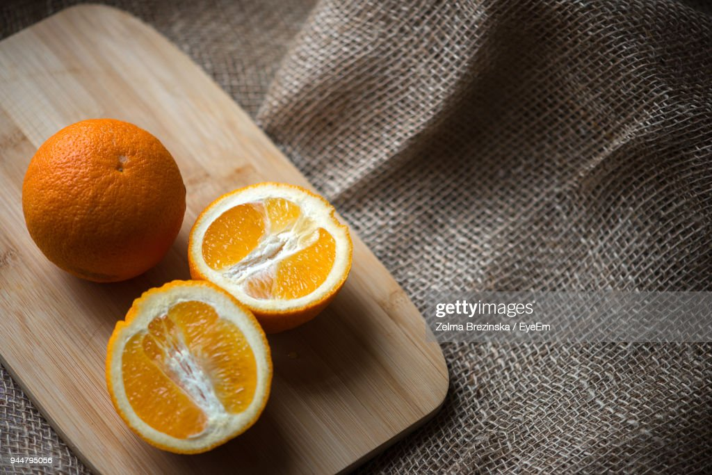 High Angle View Of Oranges On Cutting Board : Stock Photo