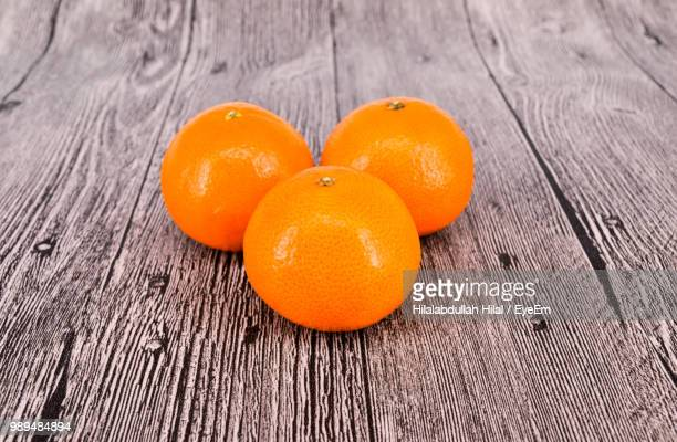 high angle view of oranges on table - hilal stock photos and pictures