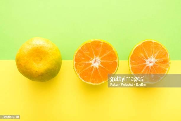 High Angle View Of Oranges Over Colored Background