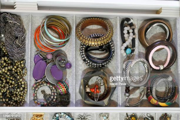 high angle view of organized jewelry in drawer - jewellery stock pictures, royalty-free photos & images