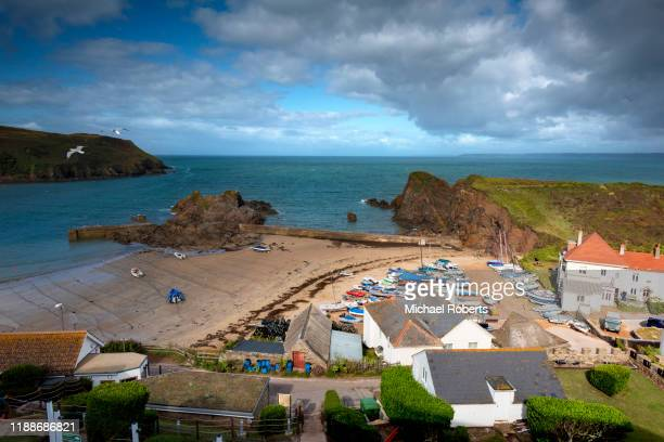 high angle view of outer hope in the seaside village of hope cove, devon - pier stock pictures, royalty-free photos & images