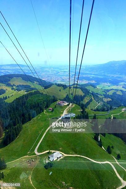 High Angle View Of Overhead Cable Car And Mountains