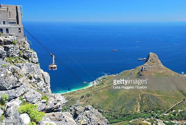 High Angle View Of Overhead Cable Car At Table Mountain By Sea