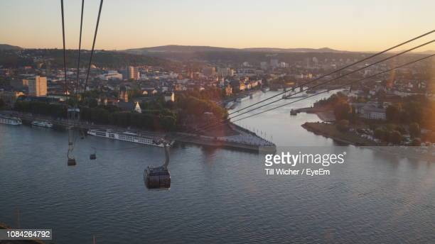 high angle view of overhead cable car over river in city - rheinland pfalz stock-fotos und bilder