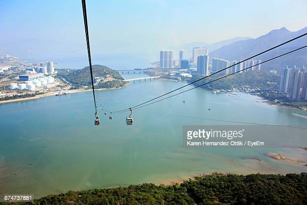 high angle view of overhead cable cars over sea against sky at lantau island - lantau stock pictures, royalty-free photos & images