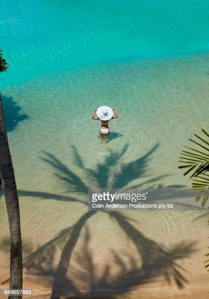 High angle view of Pacific Islander woman standing in ocean
