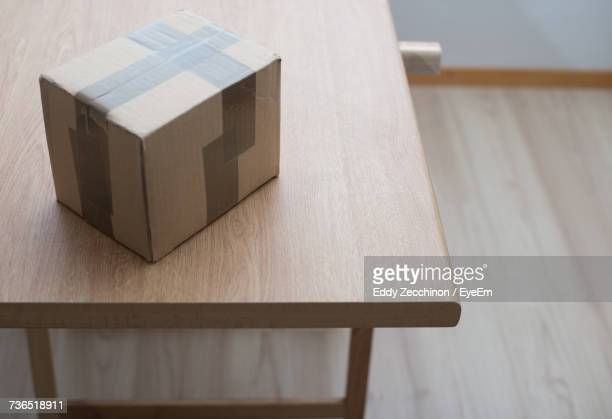high angle view of packed carton box on wooden table - carton stock pictures, royalty-free photos & images