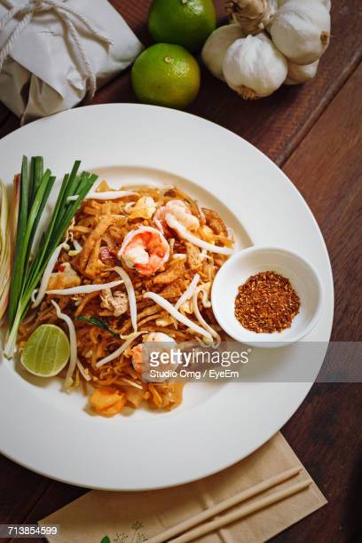 High Angle View Of Pad Thai In White Plate On Table