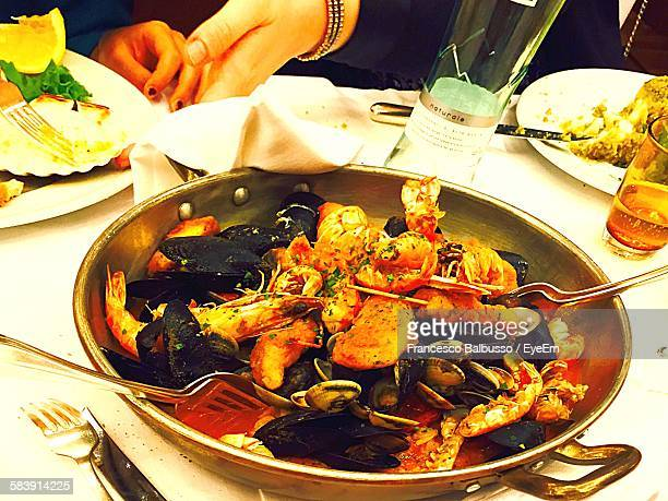 High Angle View Of Paella Served On Table At Restaurant