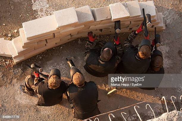 High Angle View Of Paintball Shooters In Action