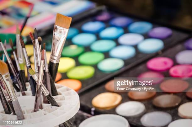high angle view of paintbrushes by palette - bicester village stock pictures, royalty-free photos & images