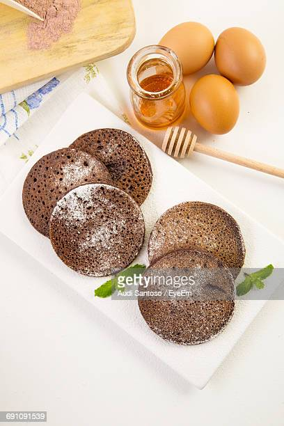 High Angle View Of Pancakes Against White Background